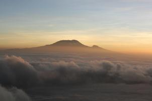 Dawn over Kilimanjaro from Rhino Point on Mount Meru summit ridge